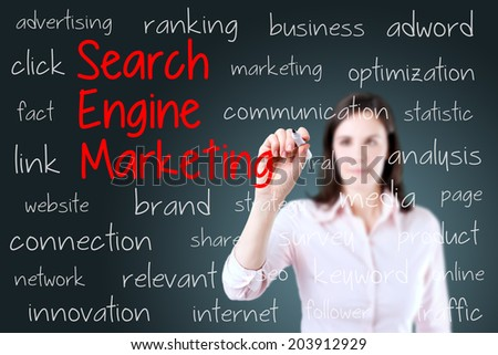 Young business woman writing search engine marketing concept. Blue background. - stock photo