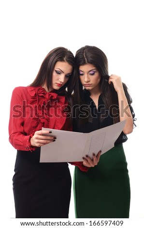 Young business women doing some paperwork - stock photo