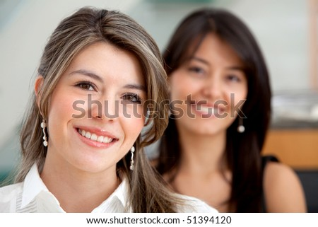 Young business women smiling at the office