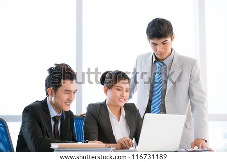 Young business workers being satisfied with their new development strategy