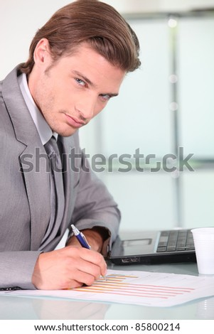 Young businessman analyzing