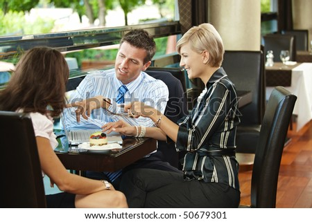 Young businessman and businesswomen having a meeting in cafe. - stock photo