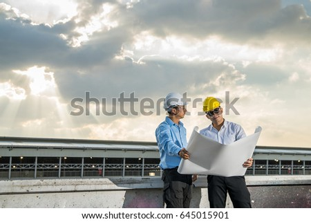 Young businessman engineer meeting looking blueprint stock photo young businessman and engineer meeting and looking blueprint paper on bright sky background future business malvernweather Image collections