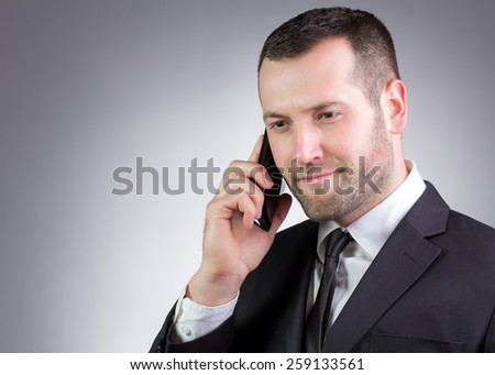 Young Businessman and handsome look speaking on the mobil phone. Vignetting - stock photo