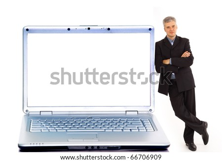 young businessman and laptop - stock photo