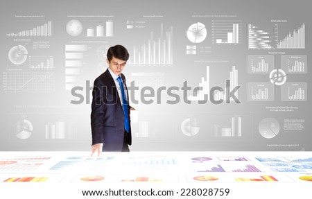 Young businessman and statistics information at background - stock photo