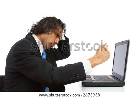 young businessman angry and hitting laptop - stock photo