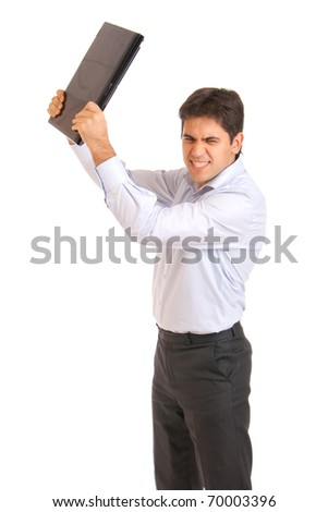 young businessman angry and smashes laptop - stock photo