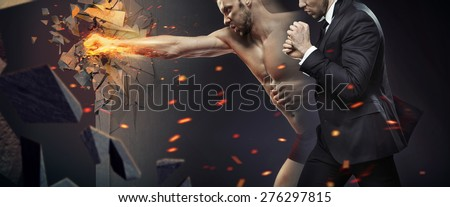 Young businessman as a successful fighter - stock photo