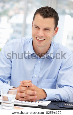 Young businessman at desk - stock photo