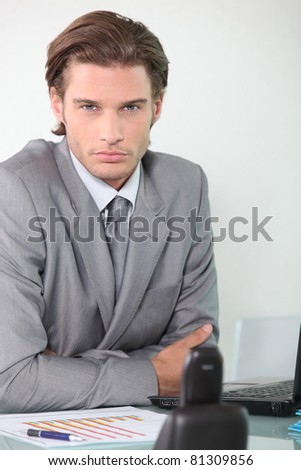Young businessman at his desk - stock photo