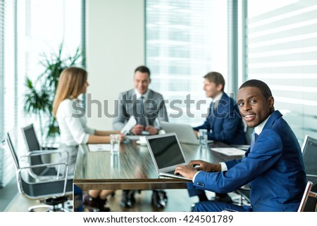 Young businessman at meeting in office - stock photo