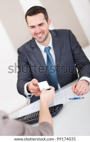 Young businessman at the hiring interview in the office - stock photo