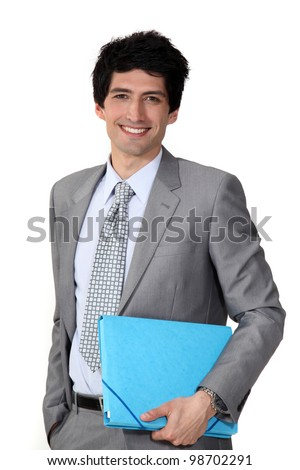 Young businessman blue folder - stock photo