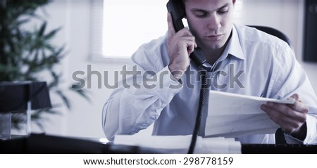 Young businessman calling the author of a letter