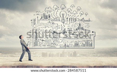 Young businessman carrying out ideas of business plan - stock photo