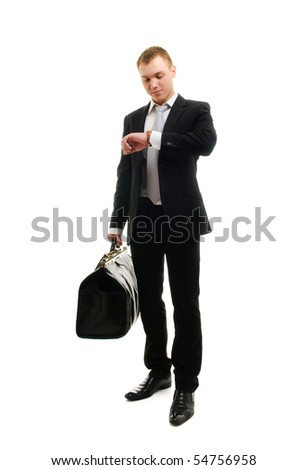 Young businessman checking his watch. Isolated over white - stock photo