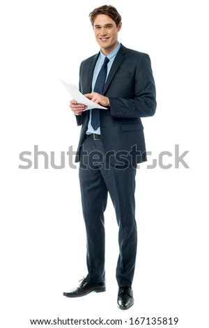 Young businessman checking the monthly progress - stock photo