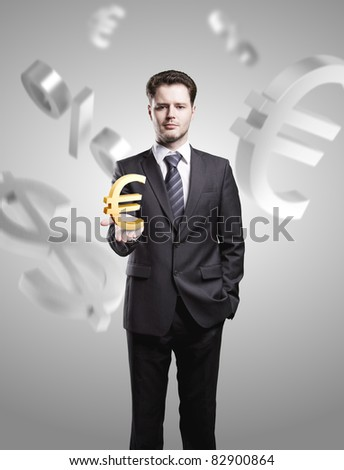 Young  businessman chooses a Gold Euro Sign - stock photo