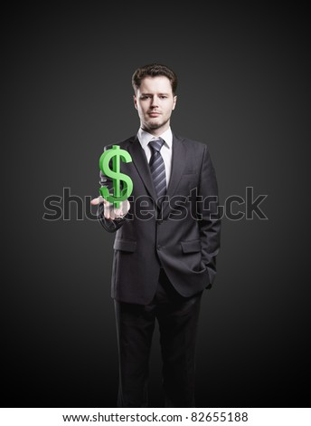 Young  businessman chooses a US dollar sign - stock photo
