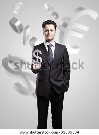 Young  businessman chooses a US dollar sign on gray background - stock photo