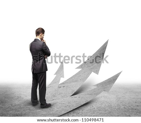 young businessman choosing right way - stock photo