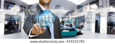 Young businessman clicking on digital application icons interface