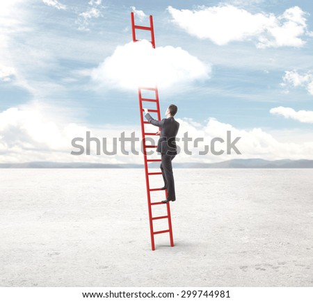 young businessman climbing on ladder to cloud - stock photo