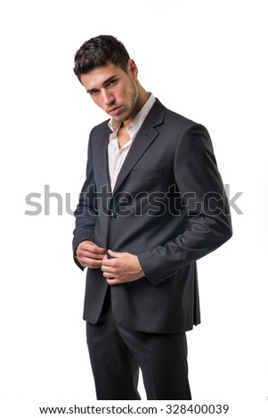 Young businessman confidently posing in front of camera, wearing suit isolated in white background