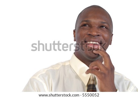 Young businessman contemplating a plan - stock photo