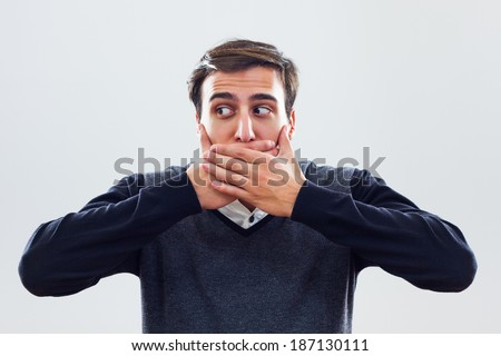 Young businessman covering mouth with hands,I will not say anything! - stock photo