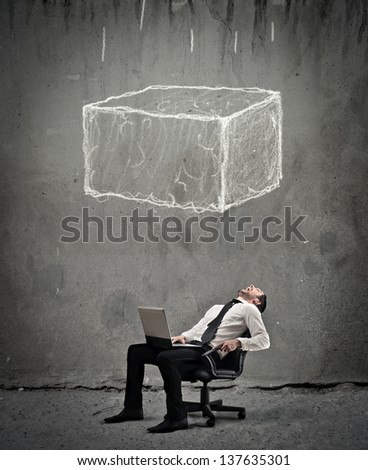 young businessman crushed by a large boulder - stock photo
