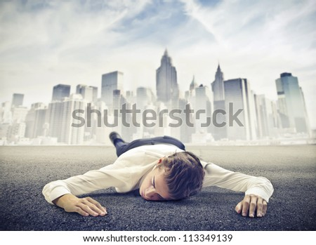 Young businessman dead on a ground near New York - stock photo