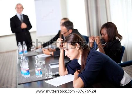 Young businessman discussing work with his colleagues at a meeting room - stock photo