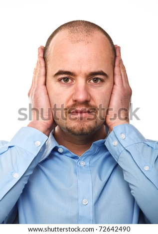 young businessman do not want to listen and close his ears - stock photo