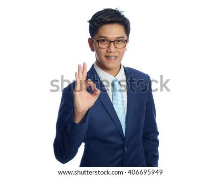Young businessman doing an okay symbol - stock photo