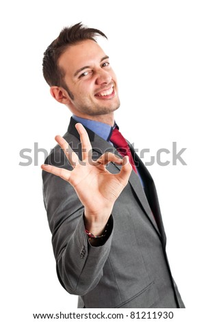 Young businessman doing the ok sign with his hand - stock photo