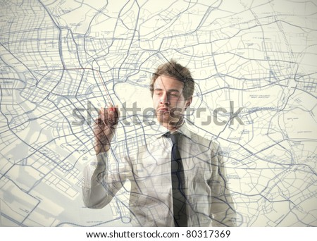 Young businessman drawing on a map - stock photo
