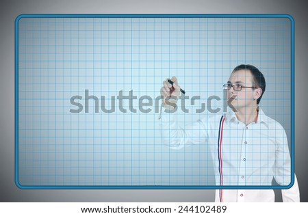 young businessman drawing on blue virtual screen - stock photo