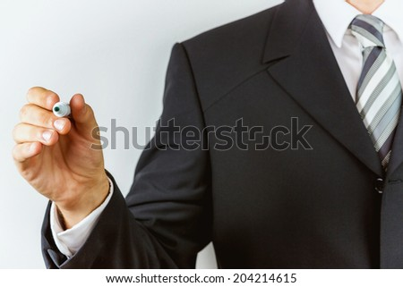 Young businessman, drawing on board. - stock photo