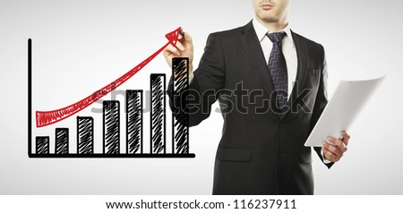 young businessman drawing profit scheme - stock photo