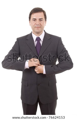 Young businessman dressing for office - stock photo