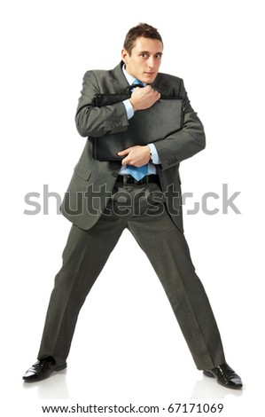 young businessman embraces a portfolio with fear. Isolated on white - stock photo
