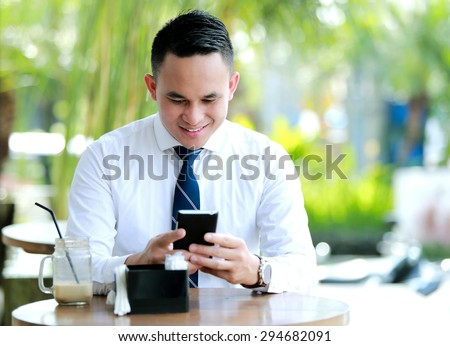 young businessman enjoy texting on leisure time - stock photo