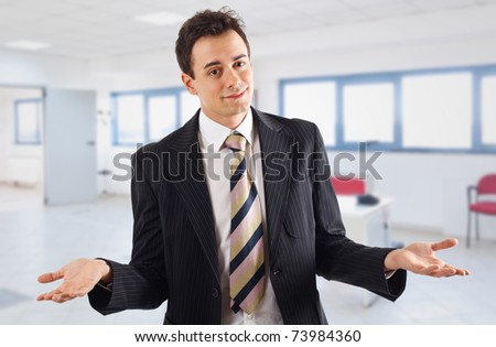 Young businessman excusing himself in his office - stock photo