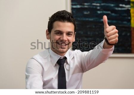 Young Businessman Executive Has The Thumb Up