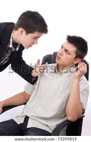 Young businessman explaining something to his boss - stock photo