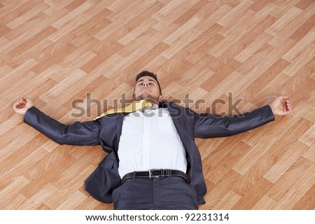 young businessman fainted on the office floor - stock photo