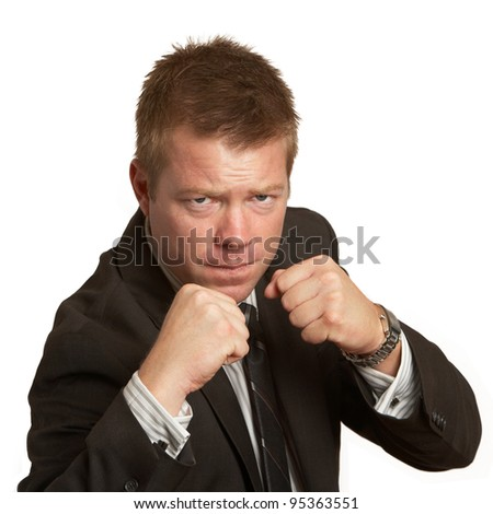 Young businessman fights up ready to fight isolated - stock photo