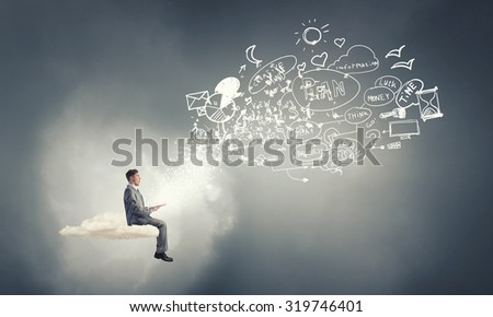 Young businessman floating on cloud with book in hands - stock photo